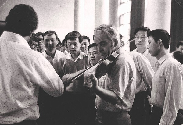 Concertmaster Norman Carol at a rehearsal with members of...