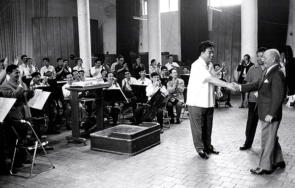 Conductor Eugene Ormandy meets with Li Delun from the Cen...
