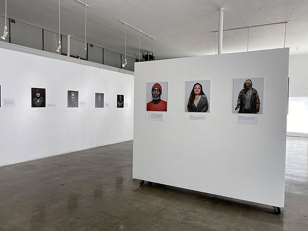 Each portrait also features a printed story from the phot...