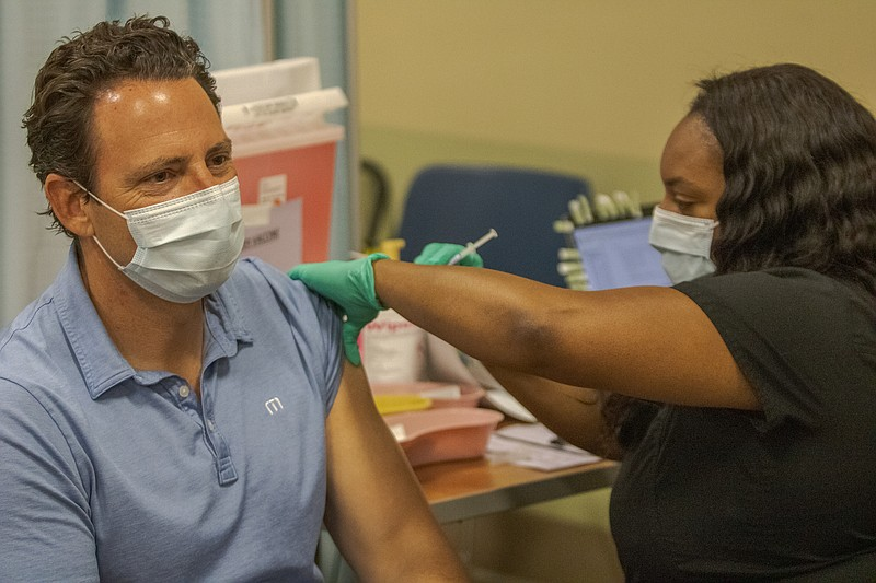 San Diego County Supervisor Nathan Fletcher receives a COVID-19 vaccine from ...