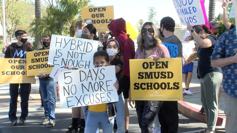Parents and students rally outside the San Marcos Unified School district off...