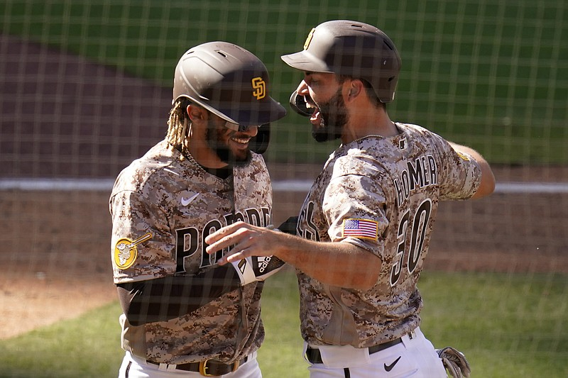 San Diego Padres' Eric Hosmer, right, reacts with teammate Fernando Tatis Jr ...