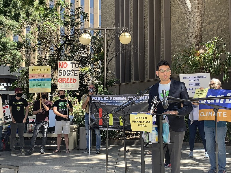 Matthew Vasilakis of the nonprofit Climate Action Campaign speaks at a rally ...