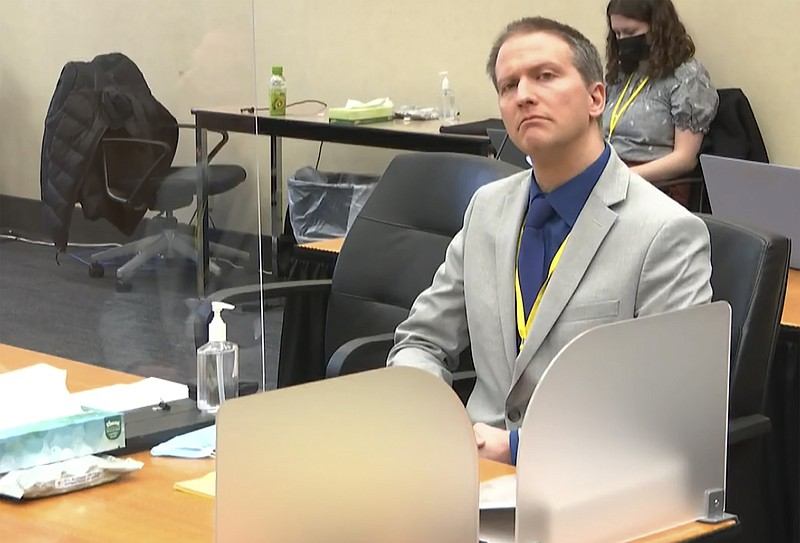 In this image from video, former Minneapolis police Officer Derek Chauvin lis...