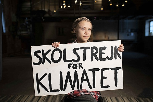 Greta Thunberg with sign close up in Stockholm.