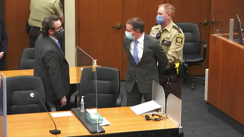 In this image from video, former Minneapolis police Officer Derek Chauvin, ce...
