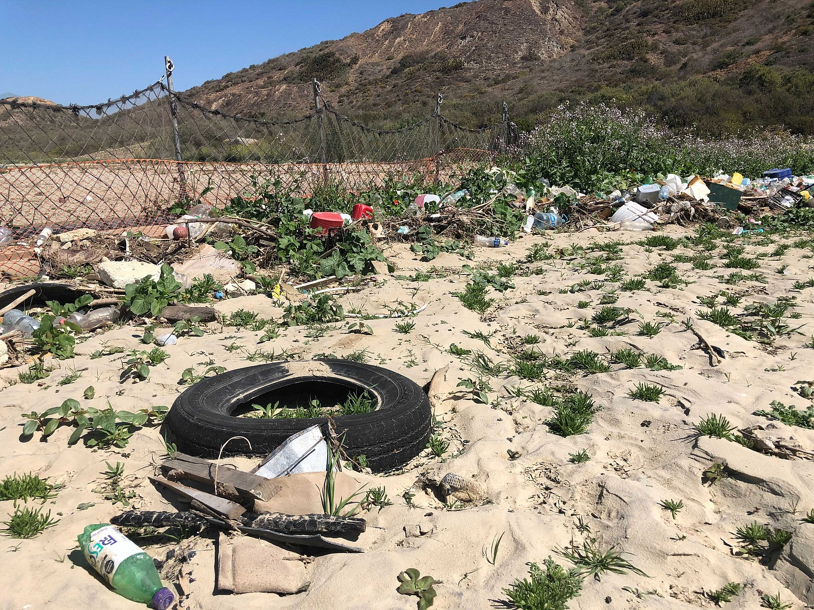 Trash caught by a collection boom in Goat Canyon near the U.S. Mexico border ...