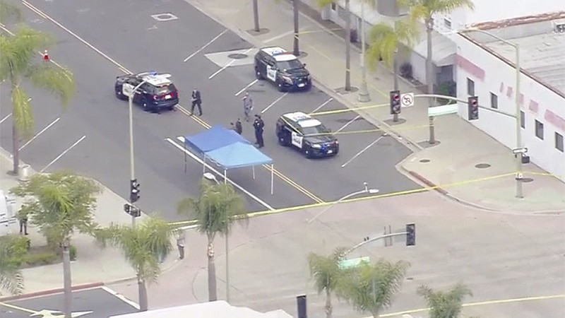 Escondido police at the scene of a fatal police-involved shooting in downtown...