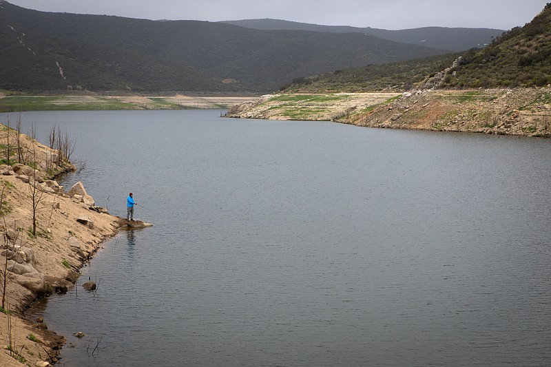 A floating dock now sits on mud at Loveland Reservoir, April 13, 2020. A cont...