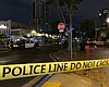 Police cars parked in the Gaslamp District foll...