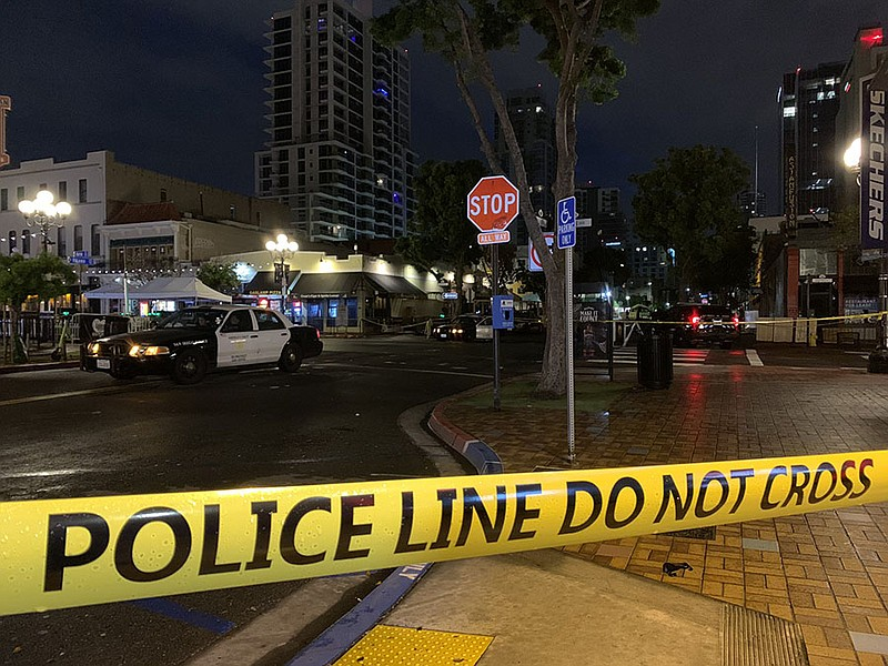 Police cars parked in the Gaslamp District following a fatal shooting, April ...