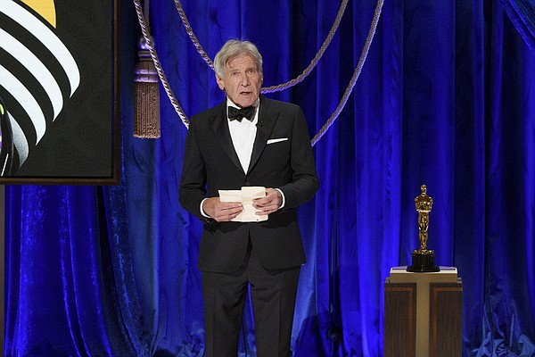 Harrison Ford presents the Oscar® for Film Editing during...