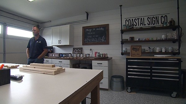 Mike Andela, former Marine, stands in his business, Coast...