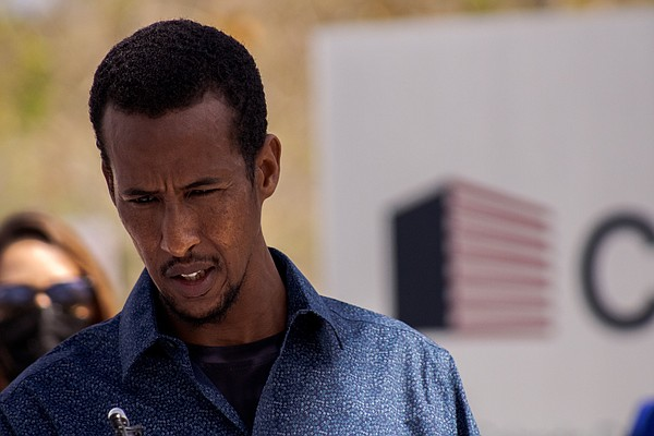 Mustafe Hassan, a refugee from Ethiopia, speaks at a news...