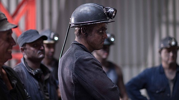 Miners in a scene from THE INDIAN DOCTOR: Season 1.