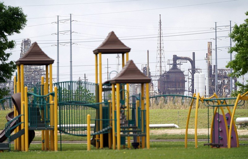 A playground outside the Prince Hall Village Apartments sits empty near one o...