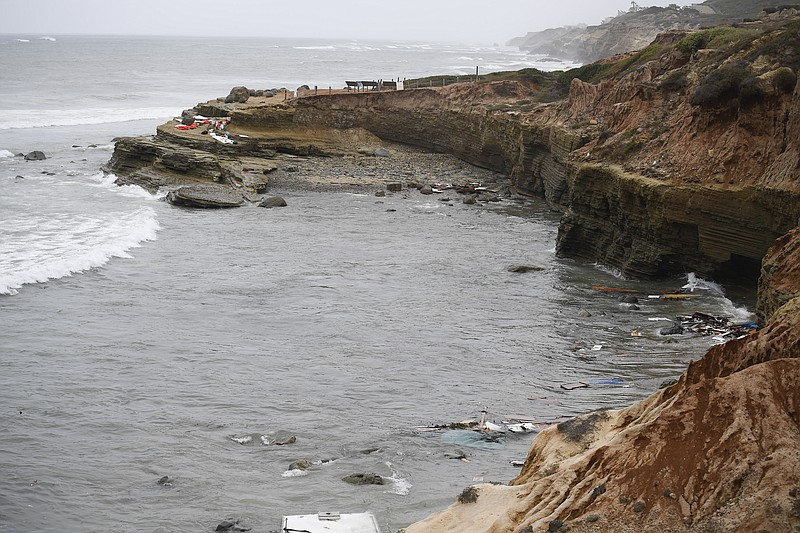 Wreckage and debris from a capsized boat washes ashore at Cabrillo National M...