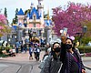 Visitors at Disneyland after it reopened to the...
