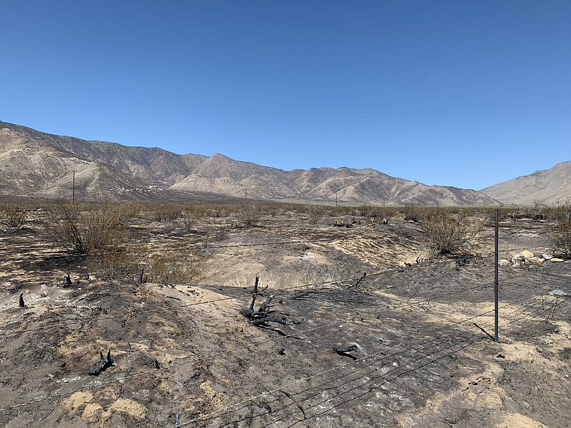 The charred patch of land from the Southern Fire in the Shelter Valley area, ...