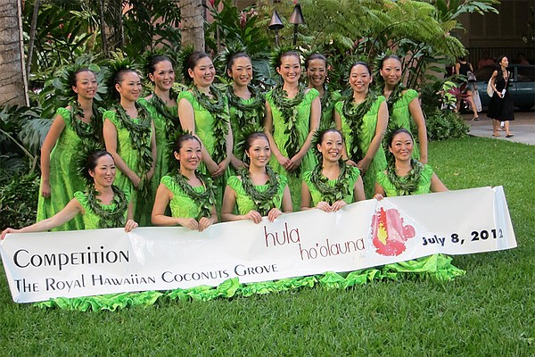 Hula dancers pose for a photo at competition, July 8, 201...