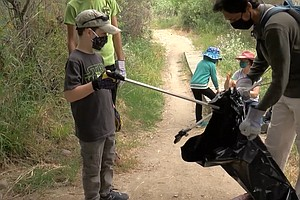 Community Volunteers Clean Up The San Diego River