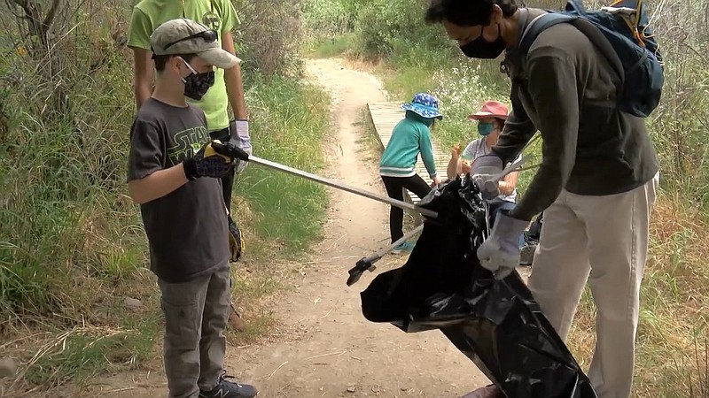 San Diego River Park Foundation staff and community volunteers gather during ...