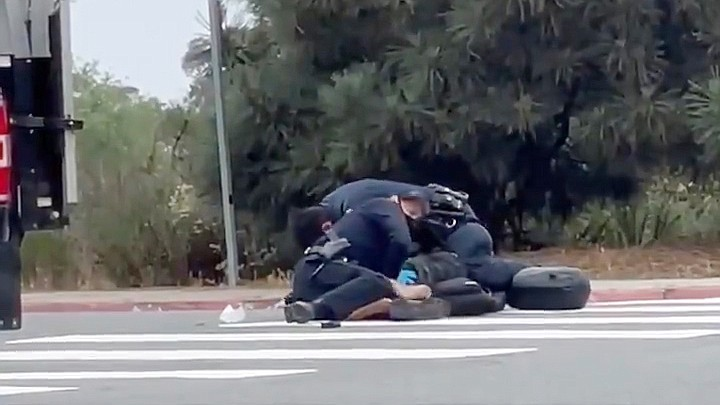 Still from a cell phone video showing a San Diego Police officer rough arrest...