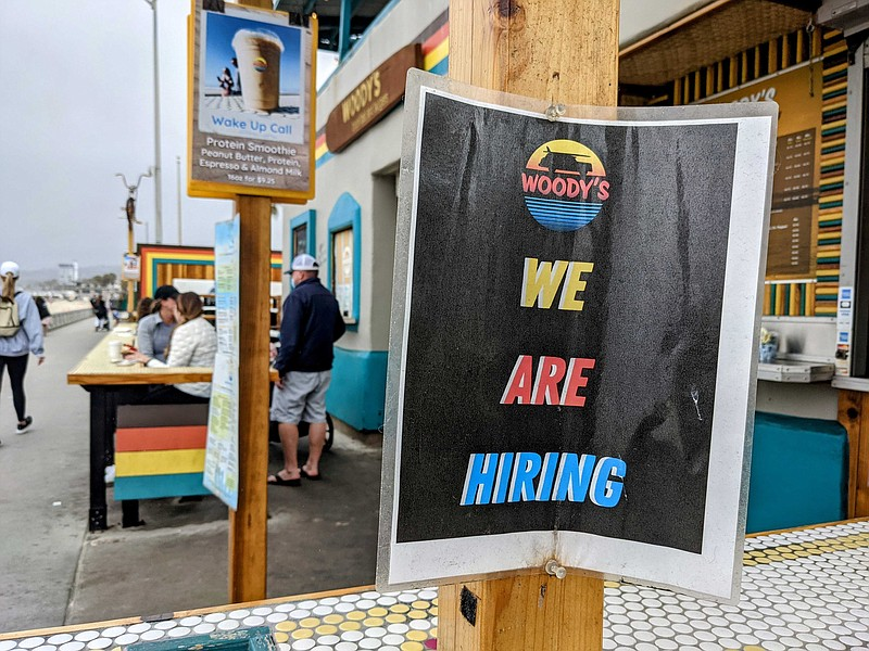 A hiring sign at Woody's in Mission Beach, May 17, 2021.