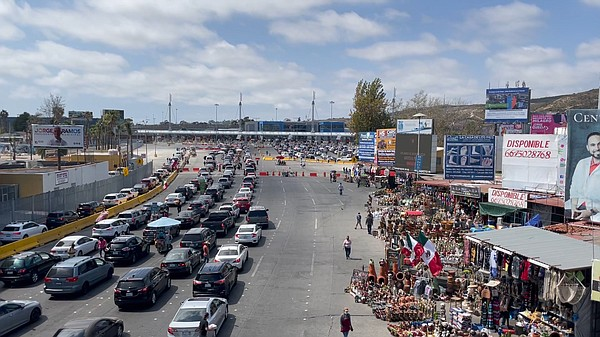 Bridge view of the San Ysidro border as vehicles are in l...
