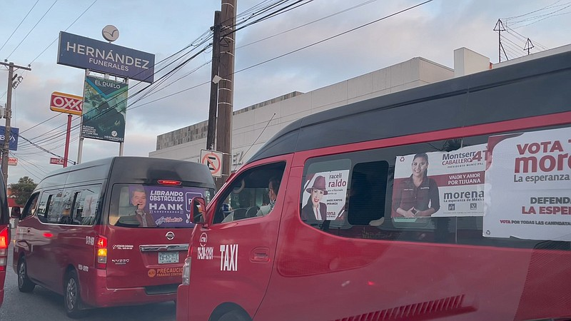 Campaign posters for the 2021 Mexican election on the windows of Tijuana taxi...