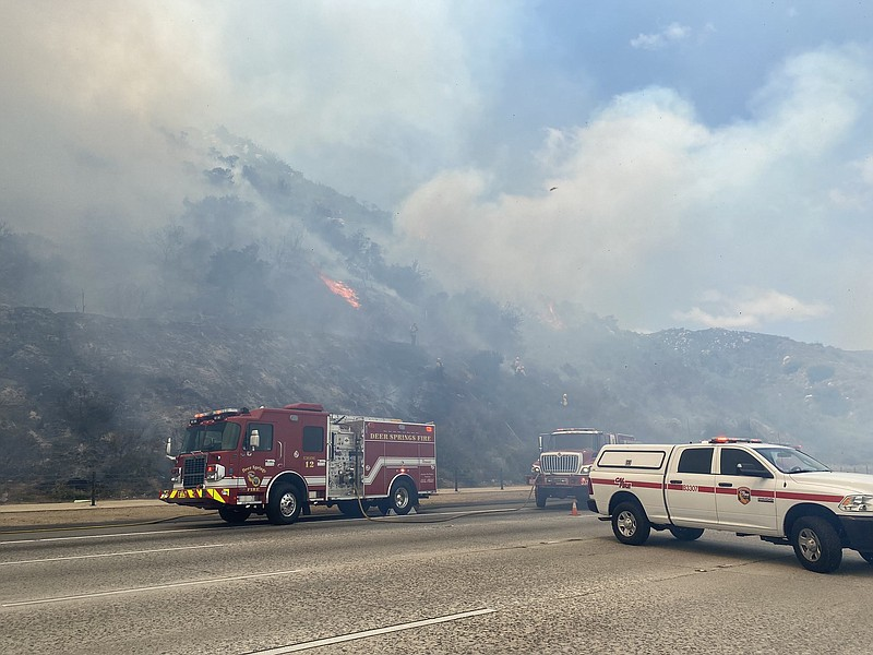 Fire engines are stopped on the southbound I-15 next to the scene of the Deer...