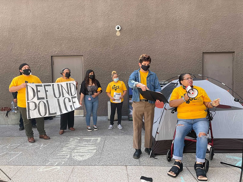 Activist protest San Diego Mayor Todd Gloria's proposal to increase the polic...
