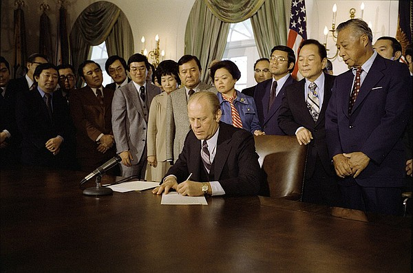 President Gerald R. Ford signing a proclamation confirmin...