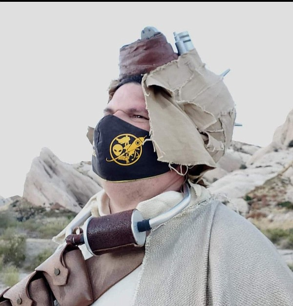 Shawn Mullen relaxing in his Tusken Raider cosplay.
