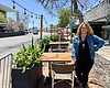 Tammy Piehl stands in the outdoor dining space ...