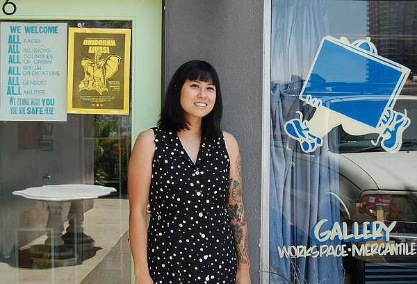 Curator Carmela Prudencio is pictured in front of Good Fa...
