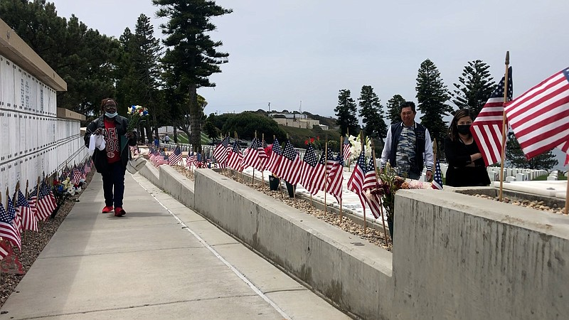 Mourners return to Fort Rosecrans National Cemetery to honor the dead on Memo...