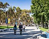 Students walk on UC San Diego campus in this un...