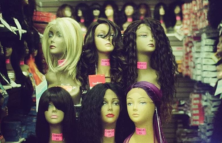 In this undated photo, a display of mannequin heads with non-racially inclusi...
