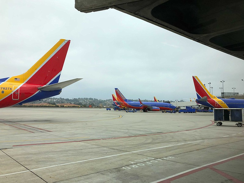Southwest Airlines planes sit at the gate at San Diego International Airport ...