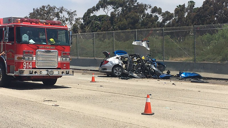 A San Diego Fire-Rescue truck is parked at the scene of a fatal car crash in ...