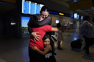 Photo for Tearful Reunion After Mom Saw AP Photo Of Daughter At Border
