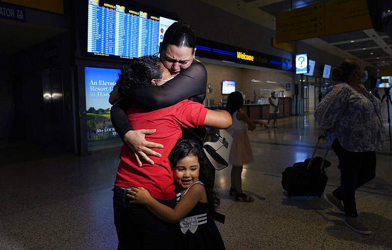 Emely, left, is reunited with her mother, Glenda Valdez and sister, Zuri, at ...