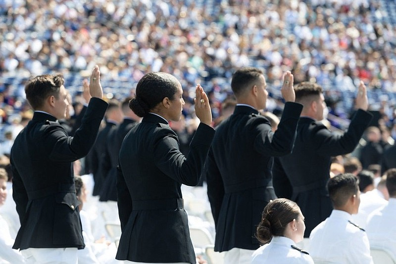 Members of the U.S. Naval Academy Class of 2021 take the oath of office to be...