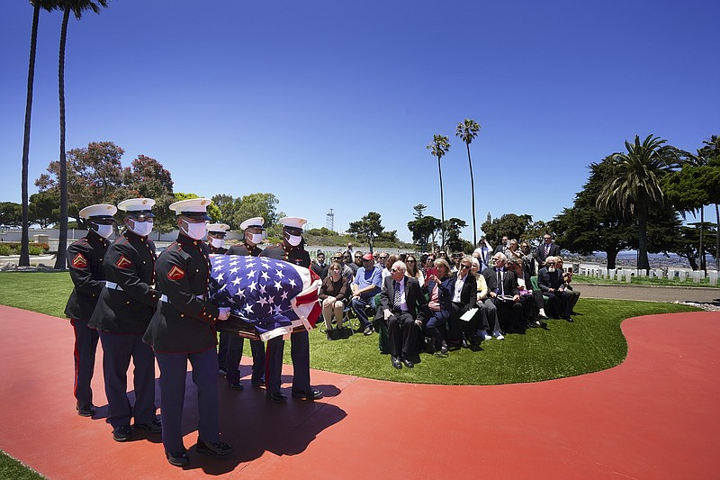 A military honor guard escorts the casket of Marine Corps Pfc. John Franklin ...