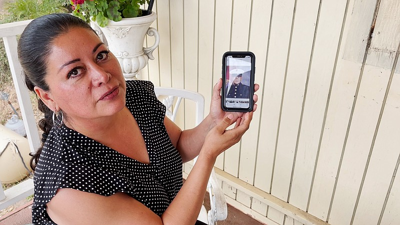 Norma Apodaca shows a photo of her brother Erasmo Apodaca from his time in th...
