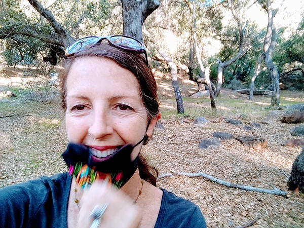 Stacy Hall wears her mask on a hike in this undated photo.
