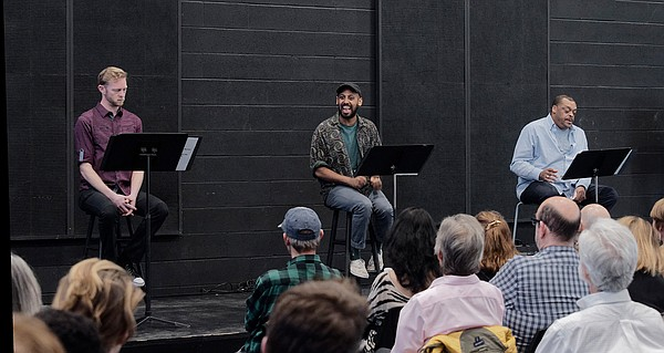 Actors read scripts before an audience in the 2019 DNA Ne...