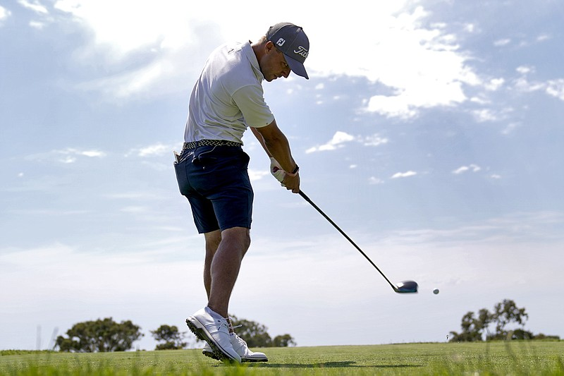 Eric Cole plays his shot from the 12th tee during a practice round of the U.S...