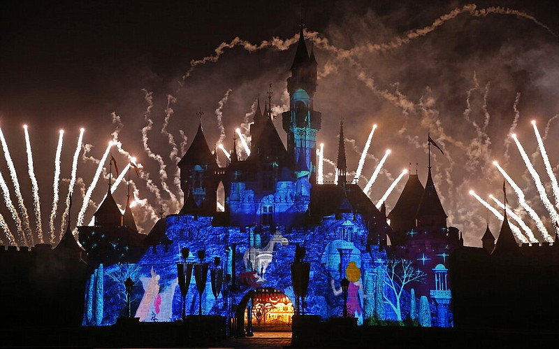 Fireworks explode over the Sleeping Beauty Castle during a ceremony at the Ho...